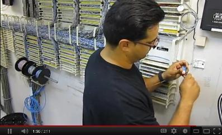 Alberto Luna, shown here terminating a UTP cable, was named 2012 Cabling Icon.