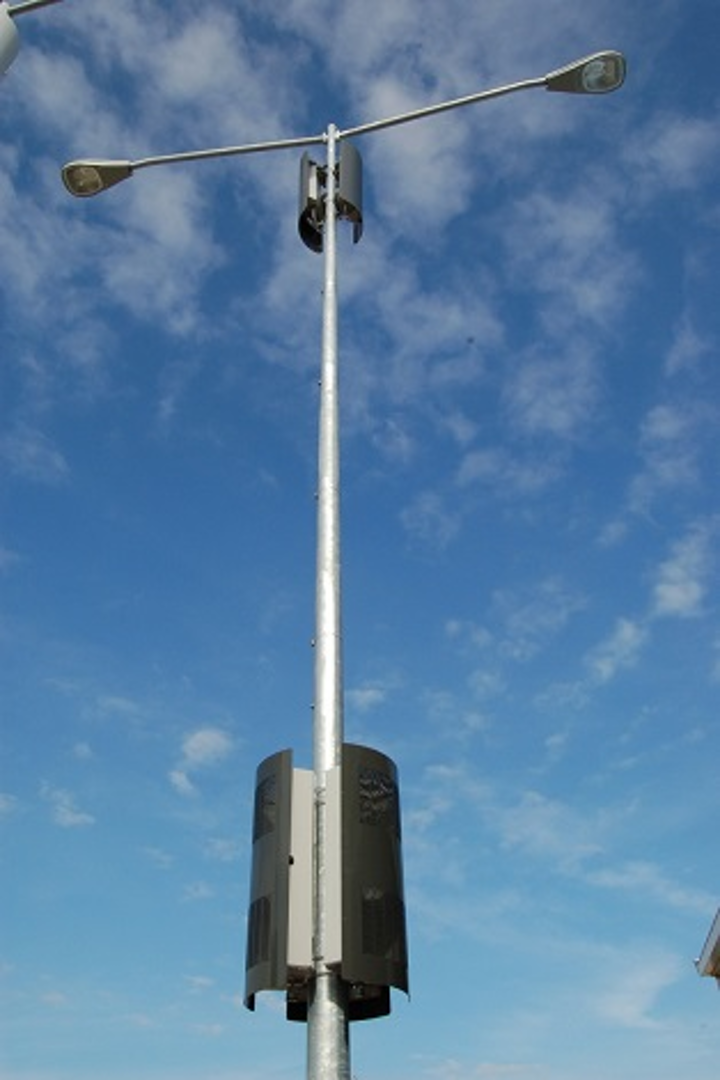 Metro cell concealment solution mounts, hides equipment on street poles