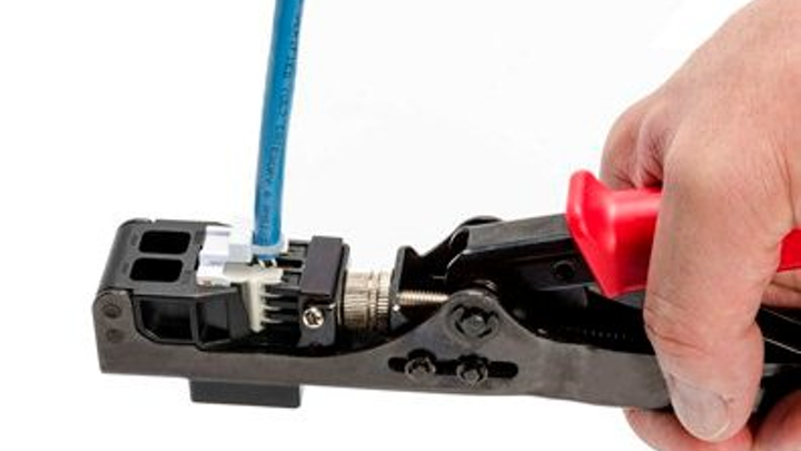 HellermannTyton's single-action jack termination tool cuts and terminates all eight wires with one squeeze of the handle.