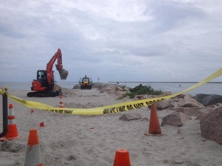 Photo credit: Rhode Island Public Radio. Investigators dig up an abandoned cable on Salty Brine Beach in Rhode Island, searching for the cause of an underground explosion. Research determined that the corroded cable indeed led to the explosion because of high hydrogen levels beneath the sand.