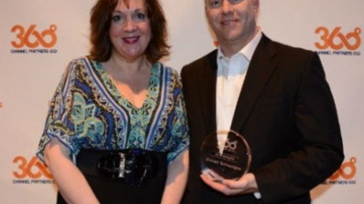 Joshua Shaw, Concert Technologies' vice president of sales, accepts Concert's Channel Partners 360 Business Value Award from Channel Partners magazine executive editor Lorna Garey.