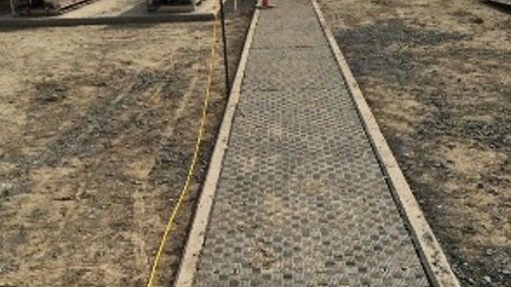 Fiberlite's composite trench cover protects the fiber cabling inside concrete trenches that serves cloud computing and other data center facilities. The covers also allow ready access to the fiber cabling.
