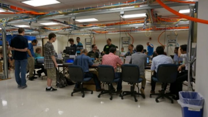 Technical experts gather and collaborate at the University of New Hampshire's InterOperability Laboratory in June 2015. The UNH-IOL hosted a 25-Gbit/sec technical feasibility event in conjunction with a 40/100-Gbit/sec plugfest, both organized by the Ethernet Alliance, in June. 25GbE cabling and networking equipment achieved a promising better-than-86-percent success rate in all test cases performed.