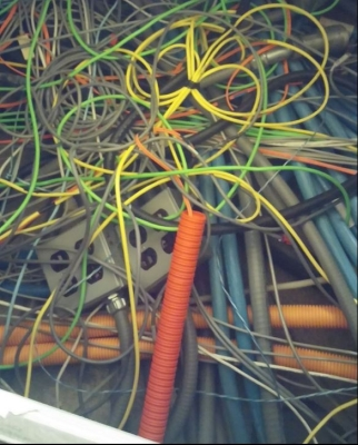 Through proper cable labeling, administration, and with the help of DCIM, network administrators can avoid a spaghetti effect like this one.