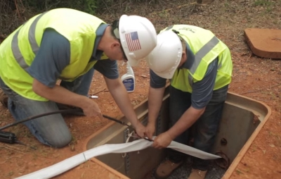 Installers place MaxCell fabric innerduct into an underground conduit. Successfully navigating congested conduit space will be a key element of preparing for 5G.